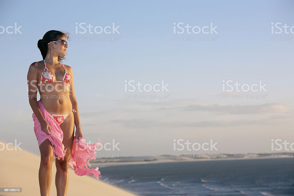 woman  bikini looking at sunset in jericoacoara royalty-free stock photo