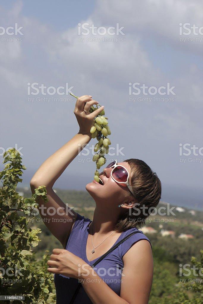 Woman bites grape royalty-free stock photo
