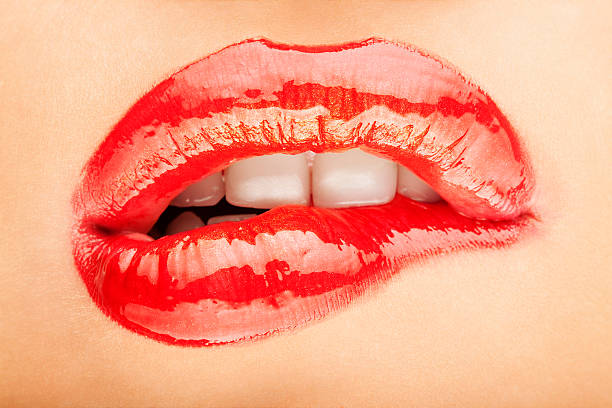 woman biting her lip - human lips stock photos and pictures