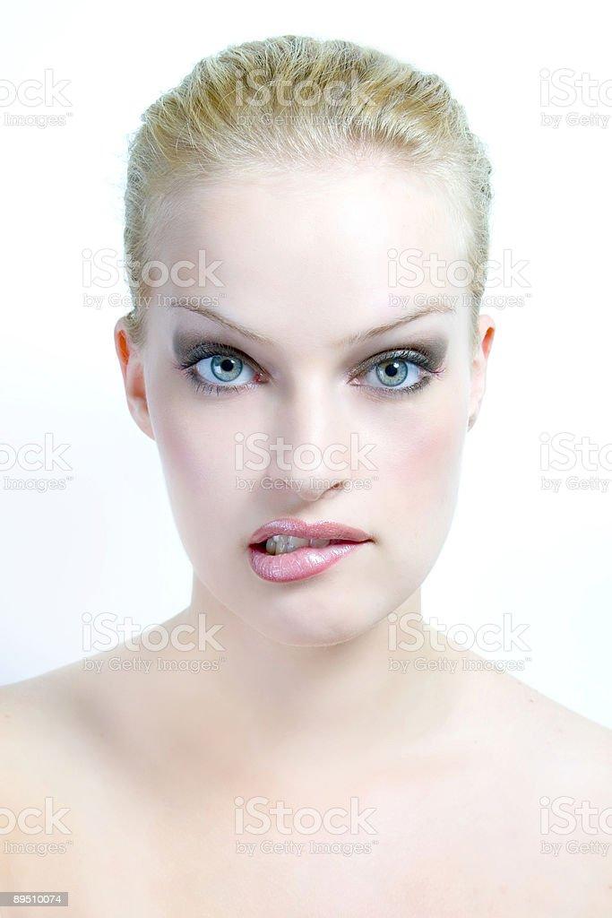 Femme mord sa lèvre photo libre de droits
