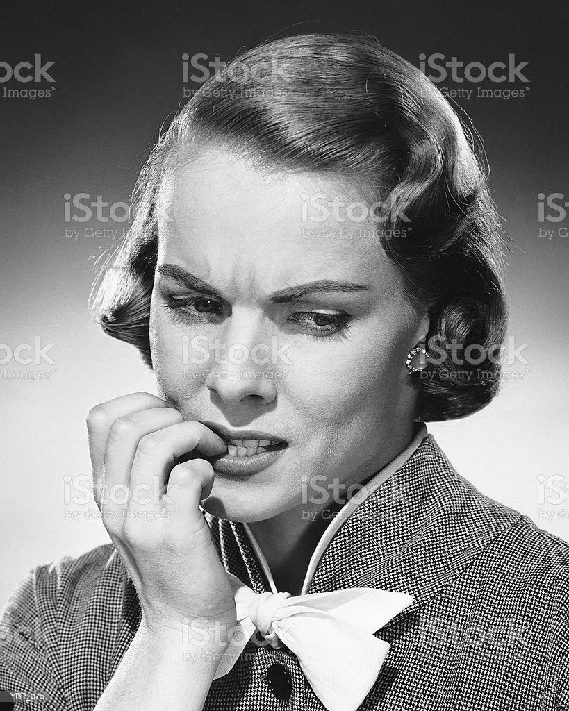 Woman biting nails royalty-free stock photo