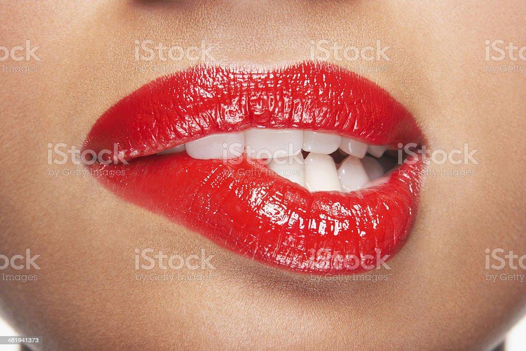 Woman Biting Red Lips stock photo
