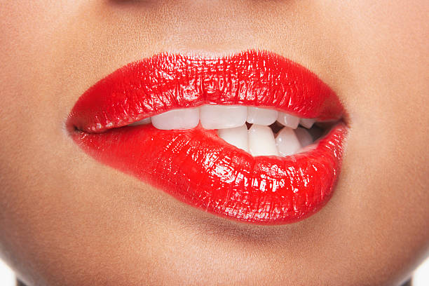 woman biting red lips - human lips stock photos and pictures