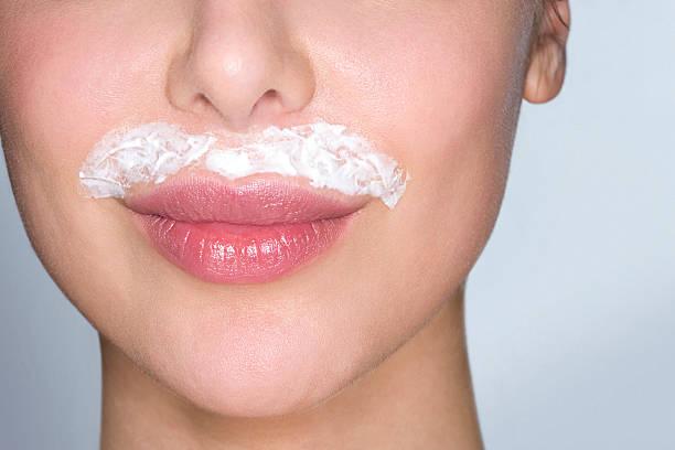 Woman bleaching facial hair  facial hair stock pictures, royalty-free photos & images