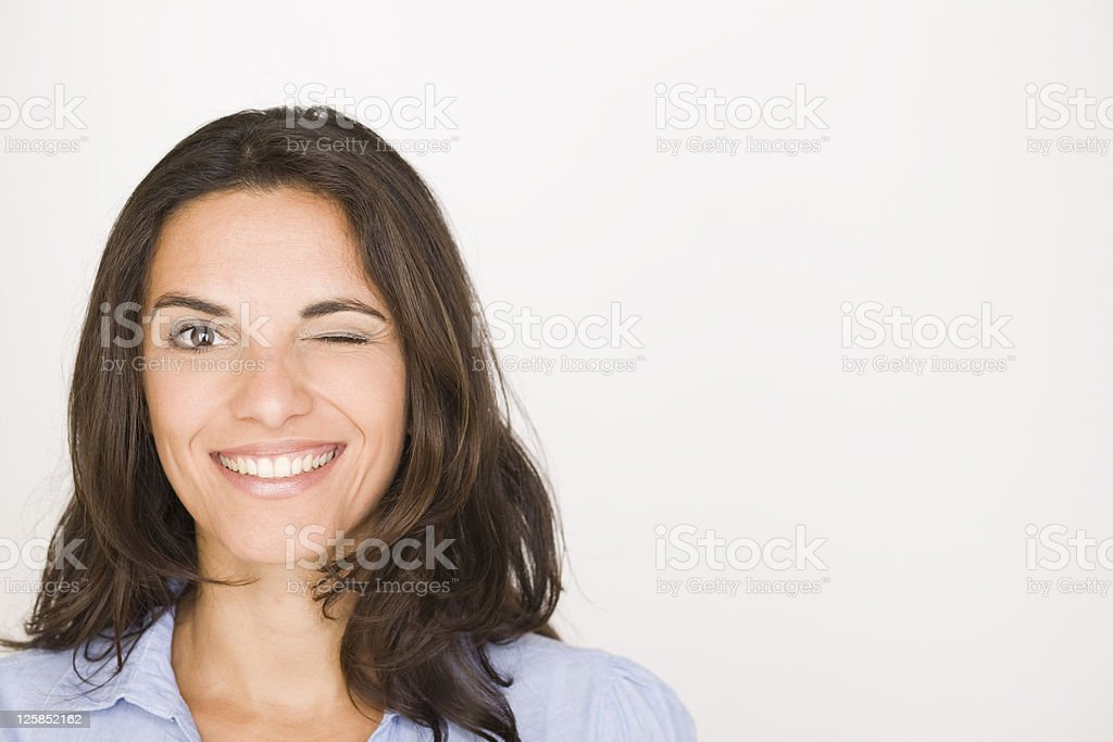 Woman blinks and twinkles stock photo