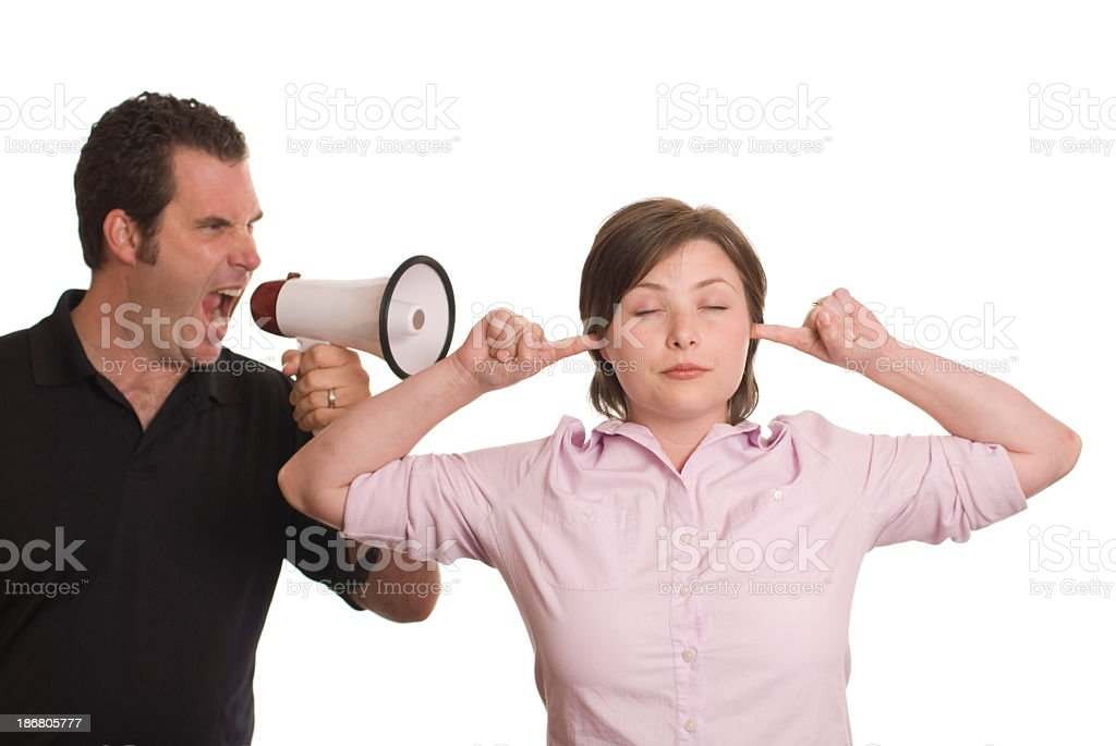 Woman blocking ears to man's yelling stock photo