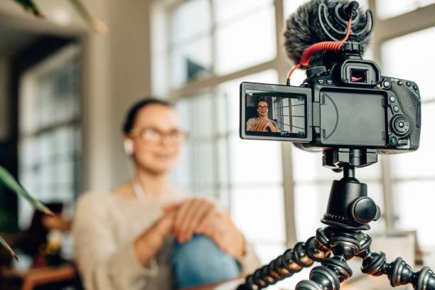 Woman blogger recording her content on camera stock photo