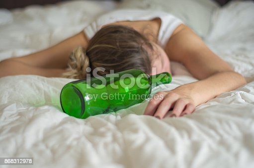 istock Woman, blond hair, fainted in bed after drinking 868312978