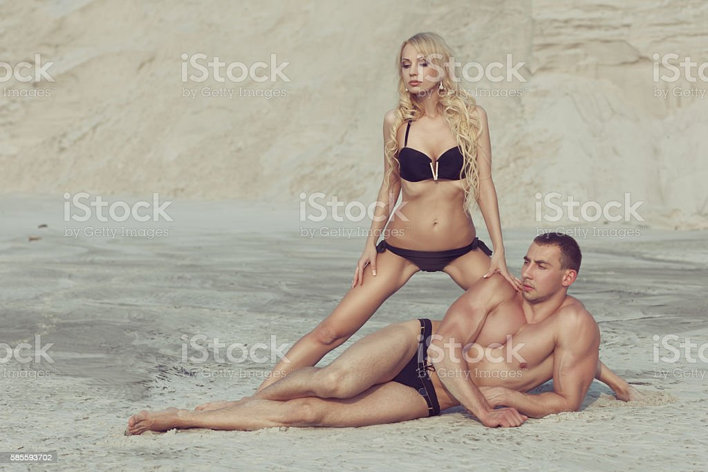 Woman blond, male bodybuilder. stock photo