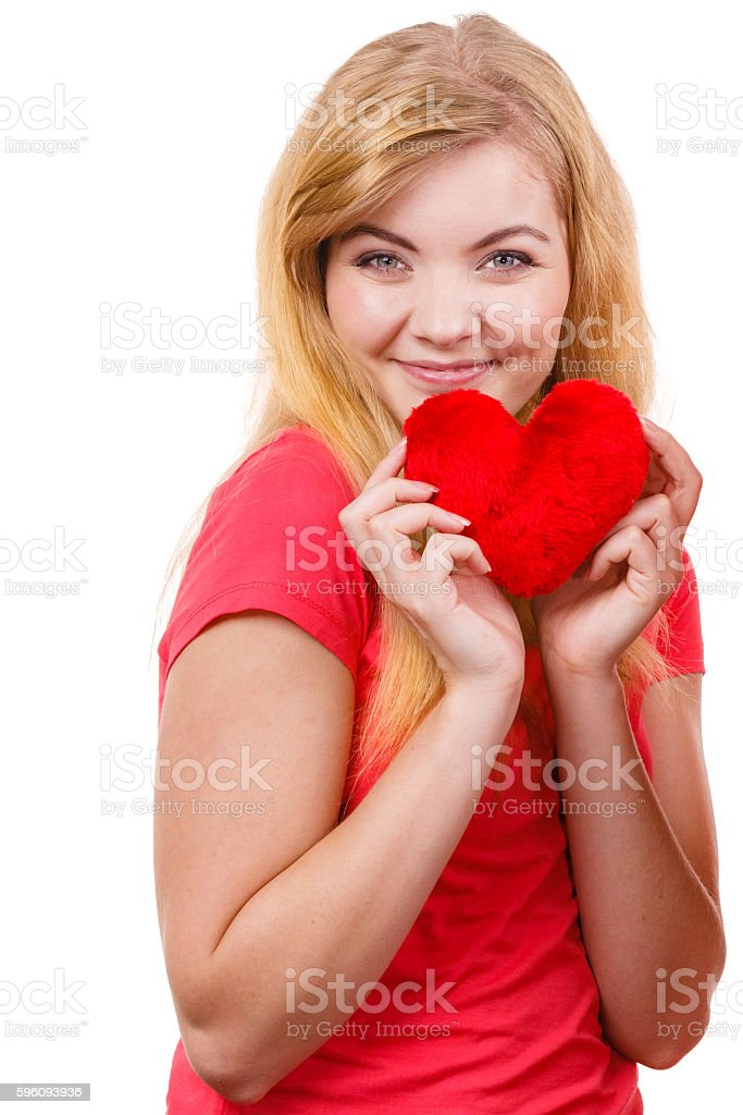 Woman blonde girl holding red heart love symbol royalty-free stock photo