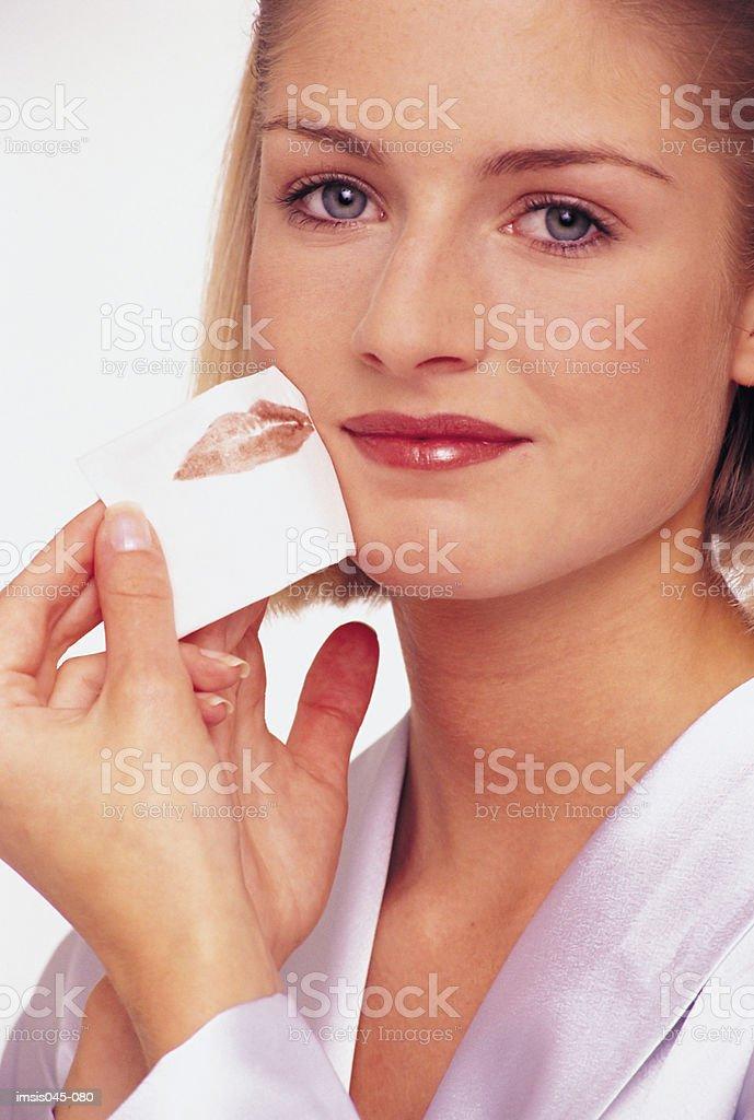 Woman blotting lips 免版稅 stock photo