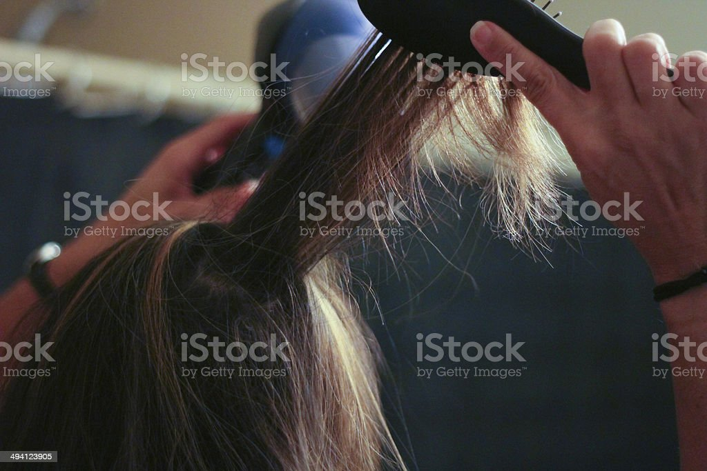 Woman Blow Drying Hair - Stock Image stock photo