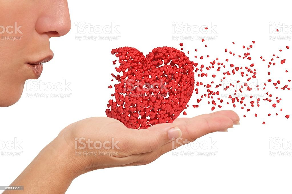 Woman blowing a heart royalty-free stock photo