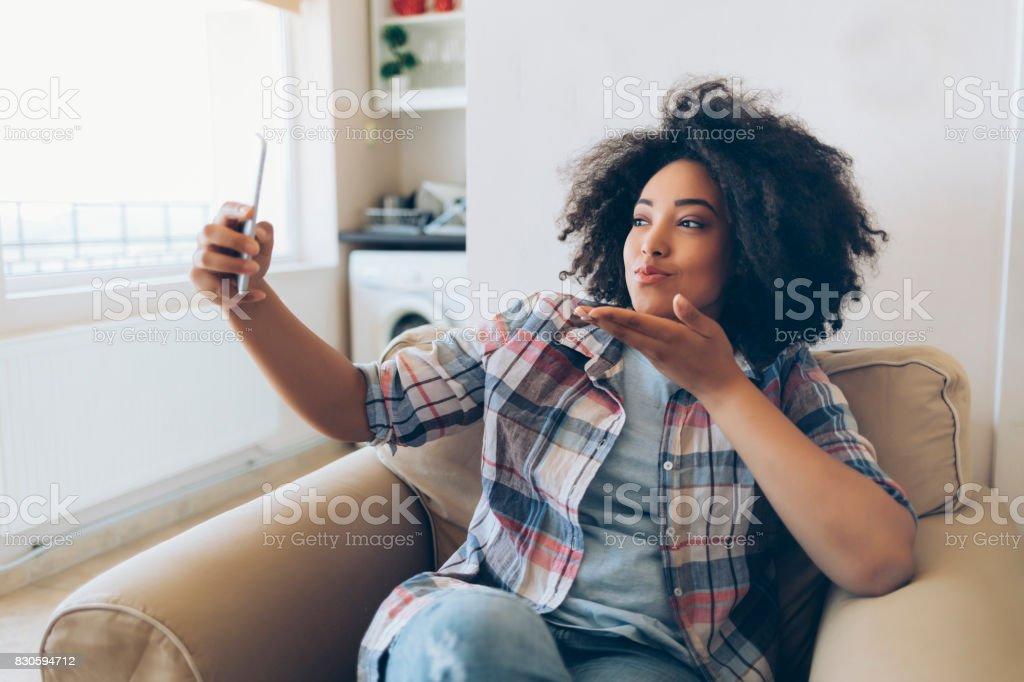 Woman blowing air kiss stock photo