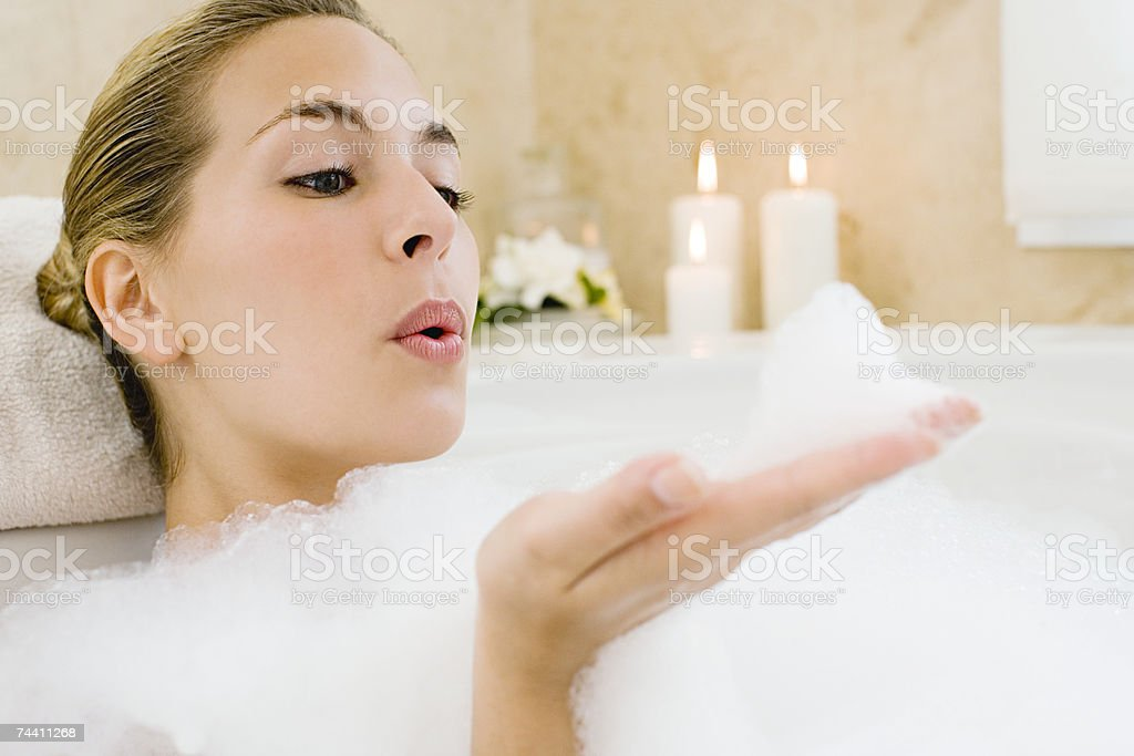 Woman blowing bubbles royalty-free stock photo
