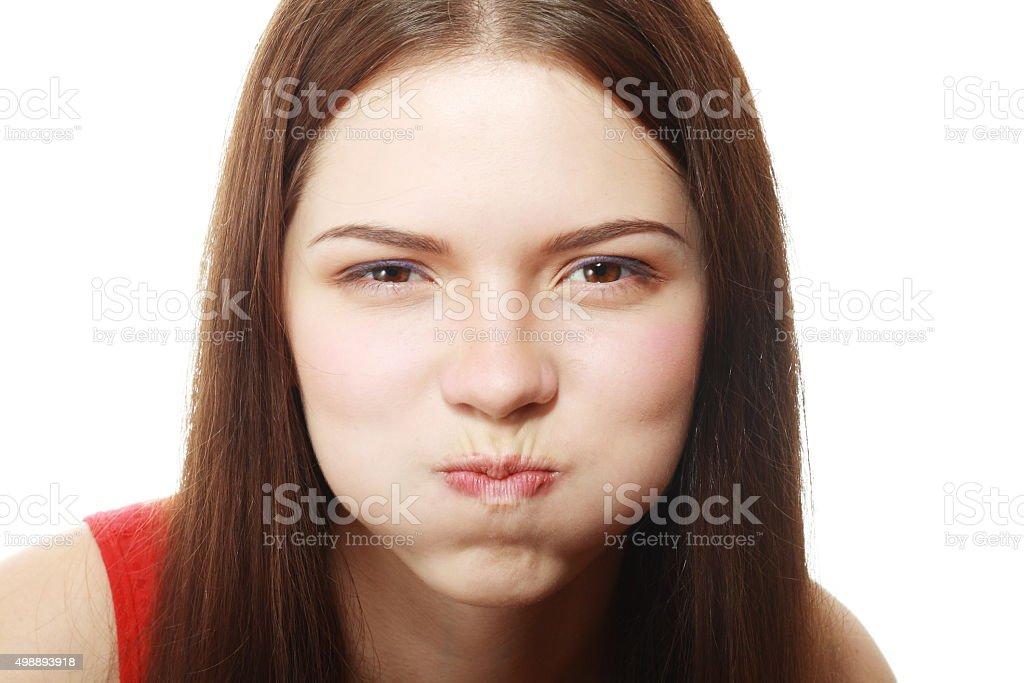 woman blowing cheeks stock photo