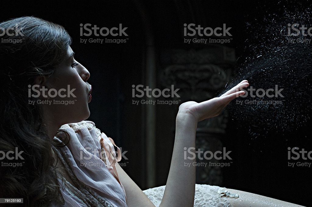 Woman blowing dust from hand royalty-free 스톡 사진