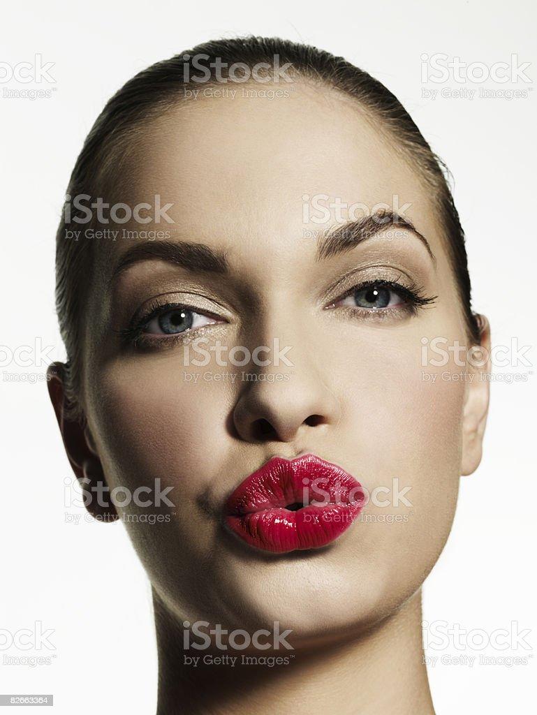 Woman blowing kiss towards camera stock photo