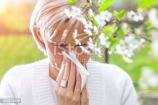 istock Woman blowing nose 493373408