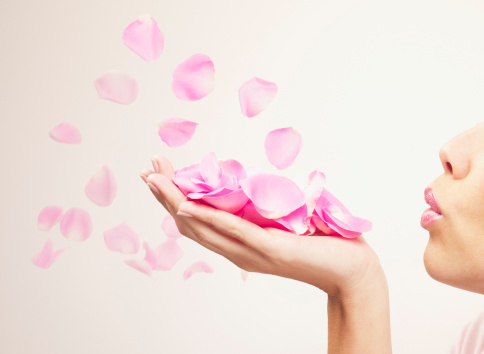 istock Woman blowing pink rose petals 103332944