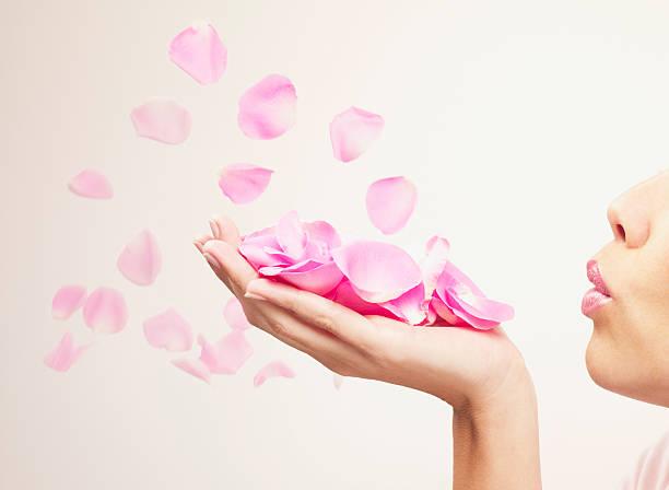 Woman blowing pink rose petals picture id103332944?b=1&k=6&m=103332944&s=612x612&w=0&h=z 9itwafc9jremreiuh5qhhagplhzehbjpci9goquua=