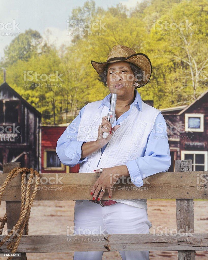 Woman Blowing Smoke stock photo