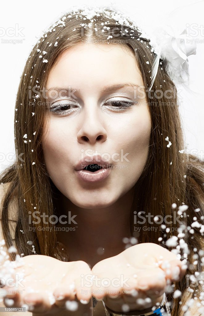 Woman Blowing Snow royalty-free stock photo