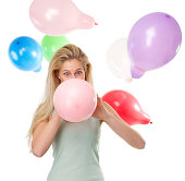 istock Woman blowing up balloons for a party 490203571