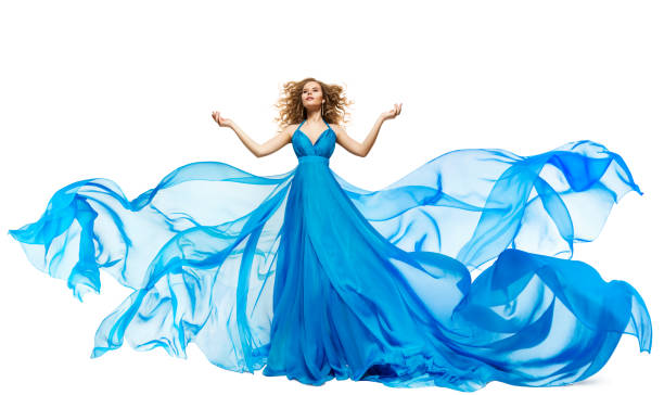 Woman Blue Dress Fluttering on Wind, Waving Silk Cloth and Hair, Artistic Fashion Gown Waving on White stock photo