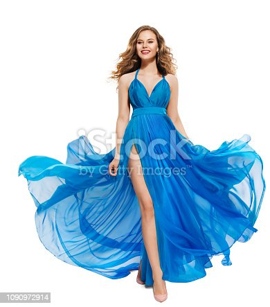 Woman Blue Dress, Happy Fashion Model in Long Waving Gown, Girl Isolated over White Background