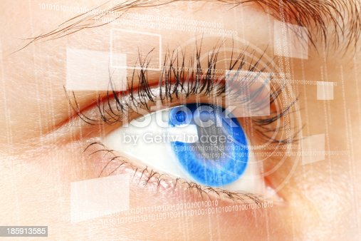 510584002istockphoto Woman blue eye looking at a digital virtual screen 185913585