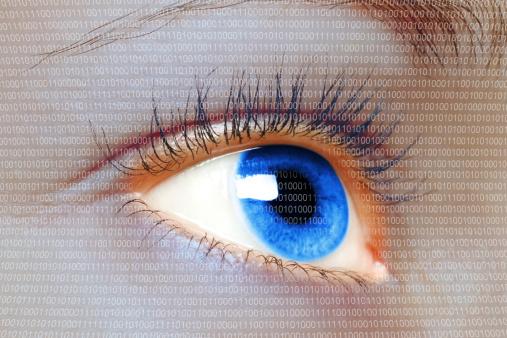 510584002 istock photo Woman blue eye looking on digital virtual screen 186268537