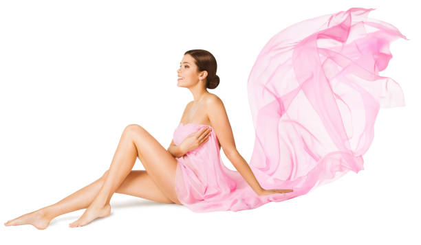 Woman Body Beauty Care, Sexy Model Sitting in Pink Flying Dress, Flowing Fabric stock photo