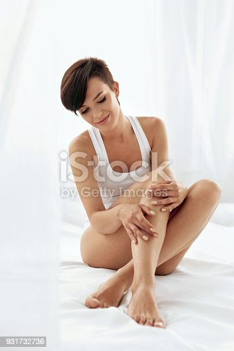 931733062 istock photo Woman Body Care. Beautiful Girl Touching Long Legs Soft Skin 931732736
