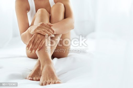 istock Woman Body Care. Close Up Of Long Legs With Soft Skin And Hands 931733062