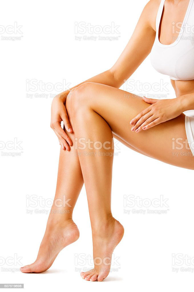 Woman Body Legs Beauty, Model Sitting on White, Leg Skin stock photo