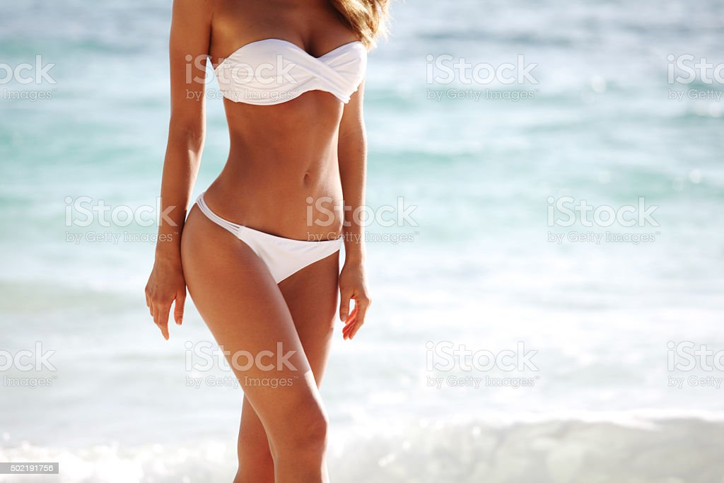 Woman body on beach background stock photo