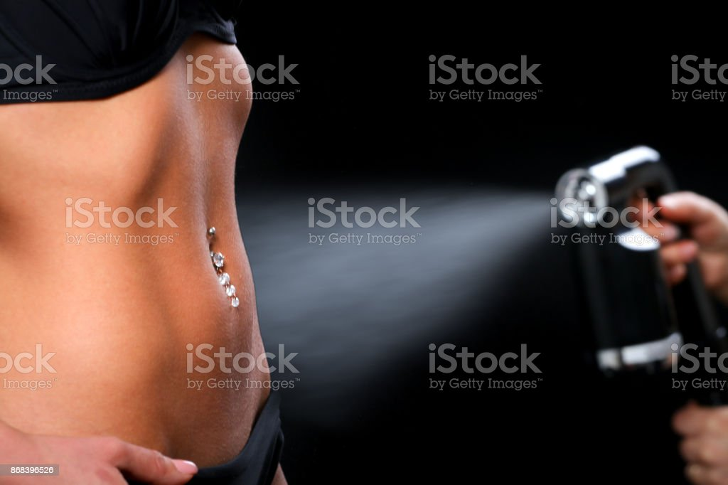 Woman body paint with airbrush stock photo