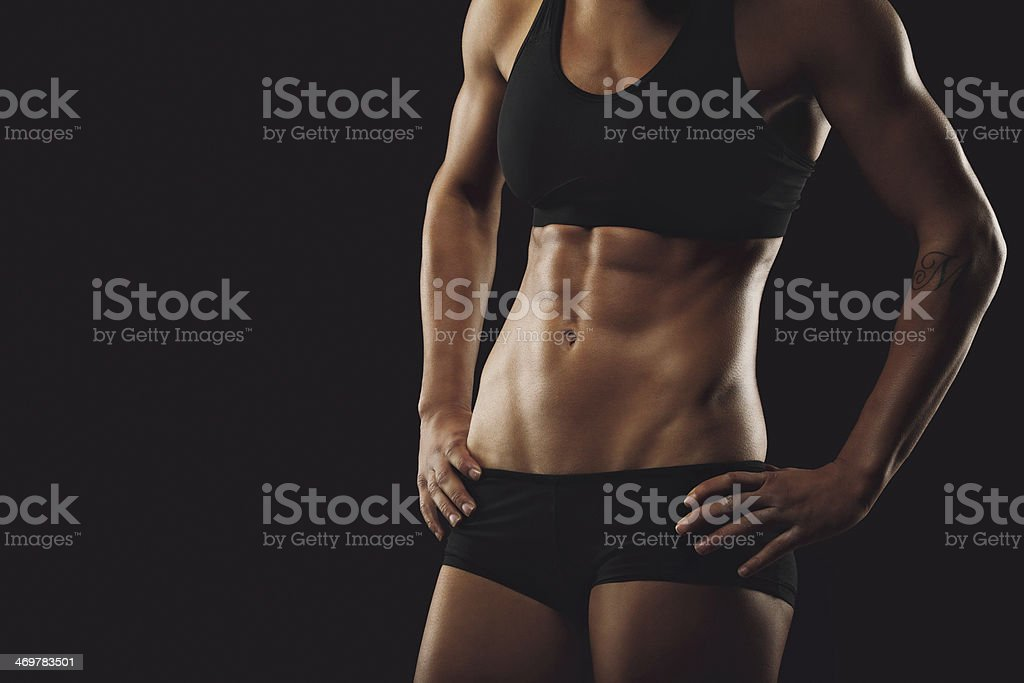 Woman body with muscular abs stock photo