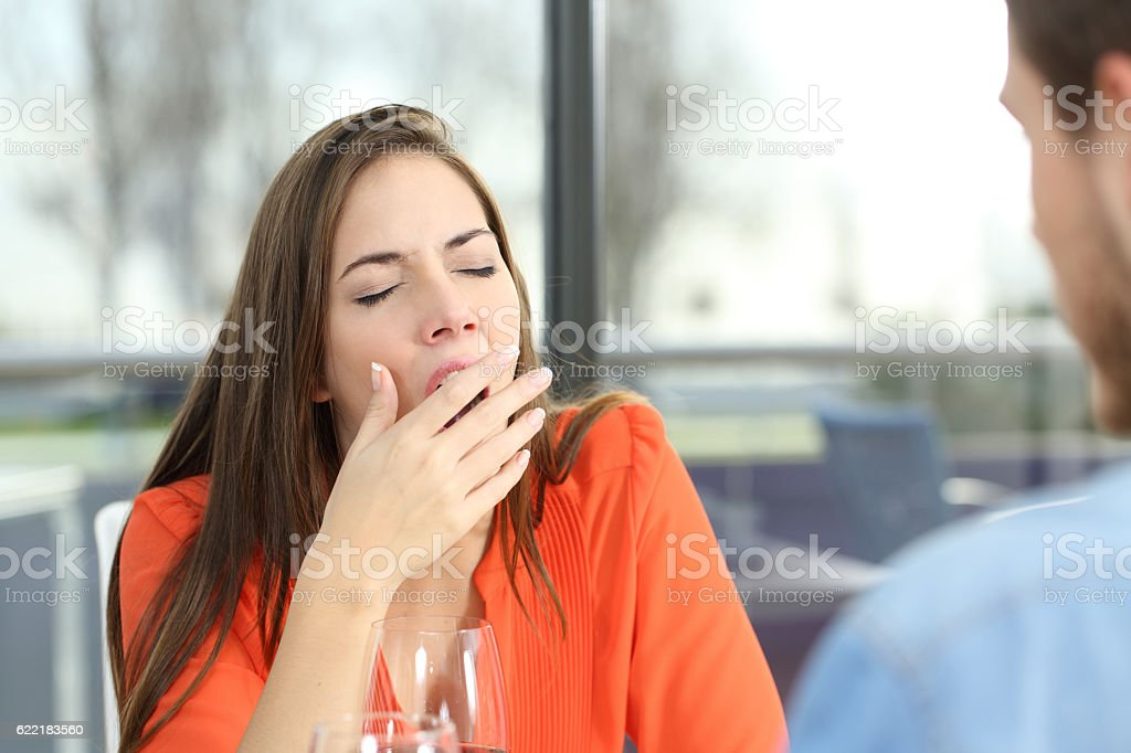 Woman bored in a bad date stock photo