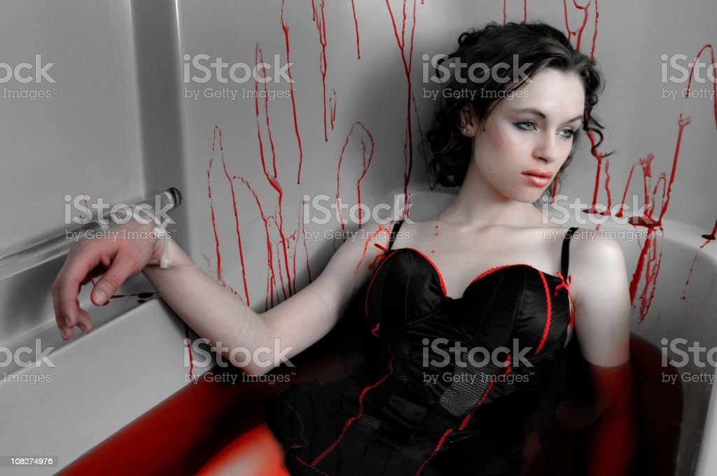 Woman Bound in Bloody Bathtub royalty-free stock photo