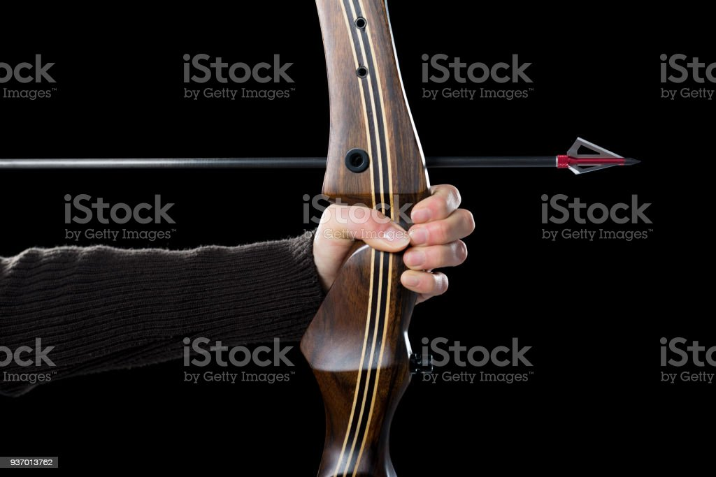 Woman bow hunting stock photo
