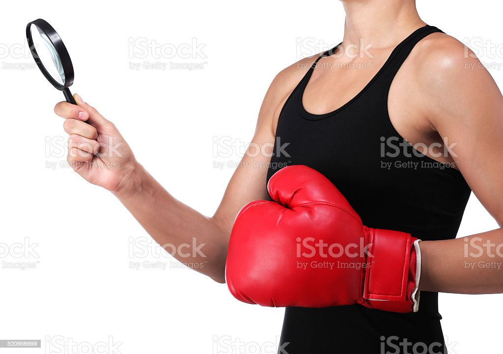 woman boxer with a magnifying glass stock photo