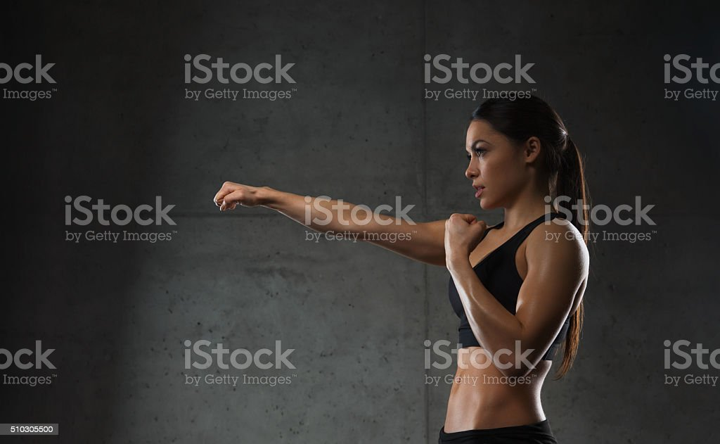 woman boxing in gym stock photo