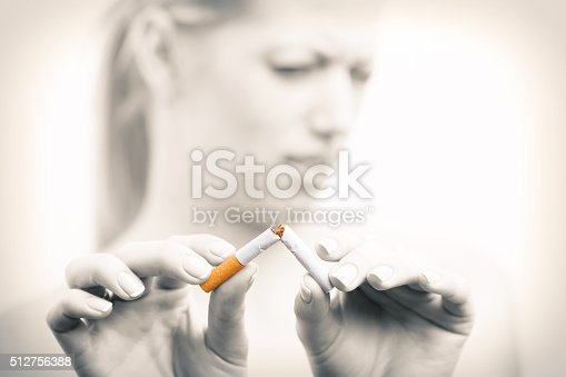 istock Woman breaking cigarette 512756388