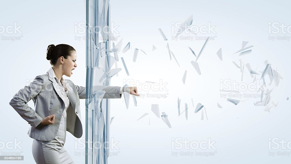 Woman breaking glass stock photo