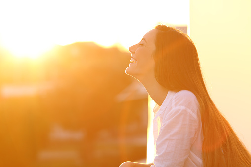 istock Woman breathing at sunset in a balcony 873956914