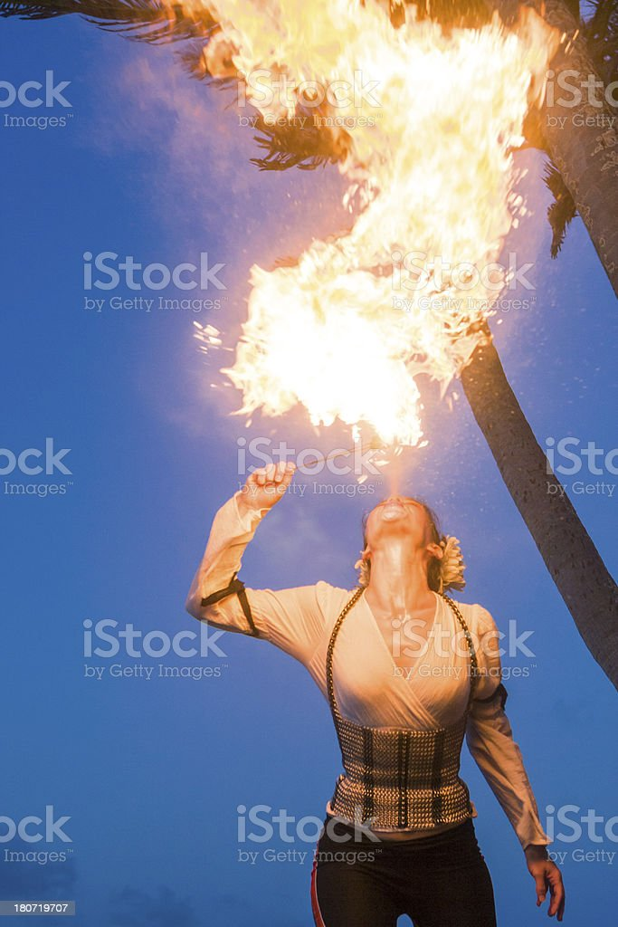 Woman breathing fire royalty-free stock photo