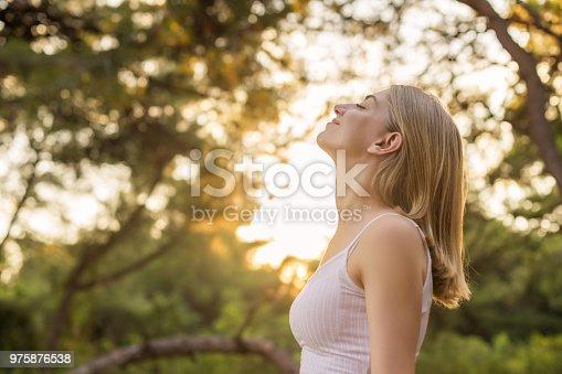 Woman breathing fresh in forest