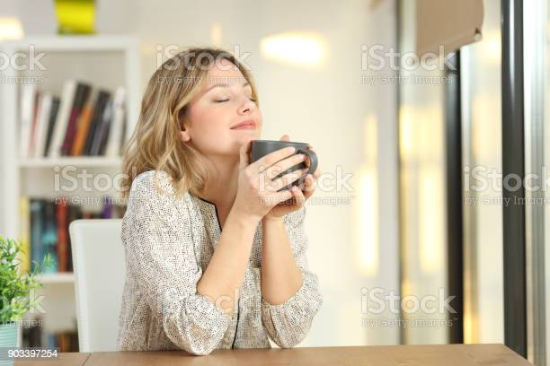 Woman breathing holding a coffee mug at home picture id903397254?b=1&k=6&m=903397254&s=612x612&h=1u6e2br5c31uy03eivpzb3squzq2ly4o2hbedefzku0=